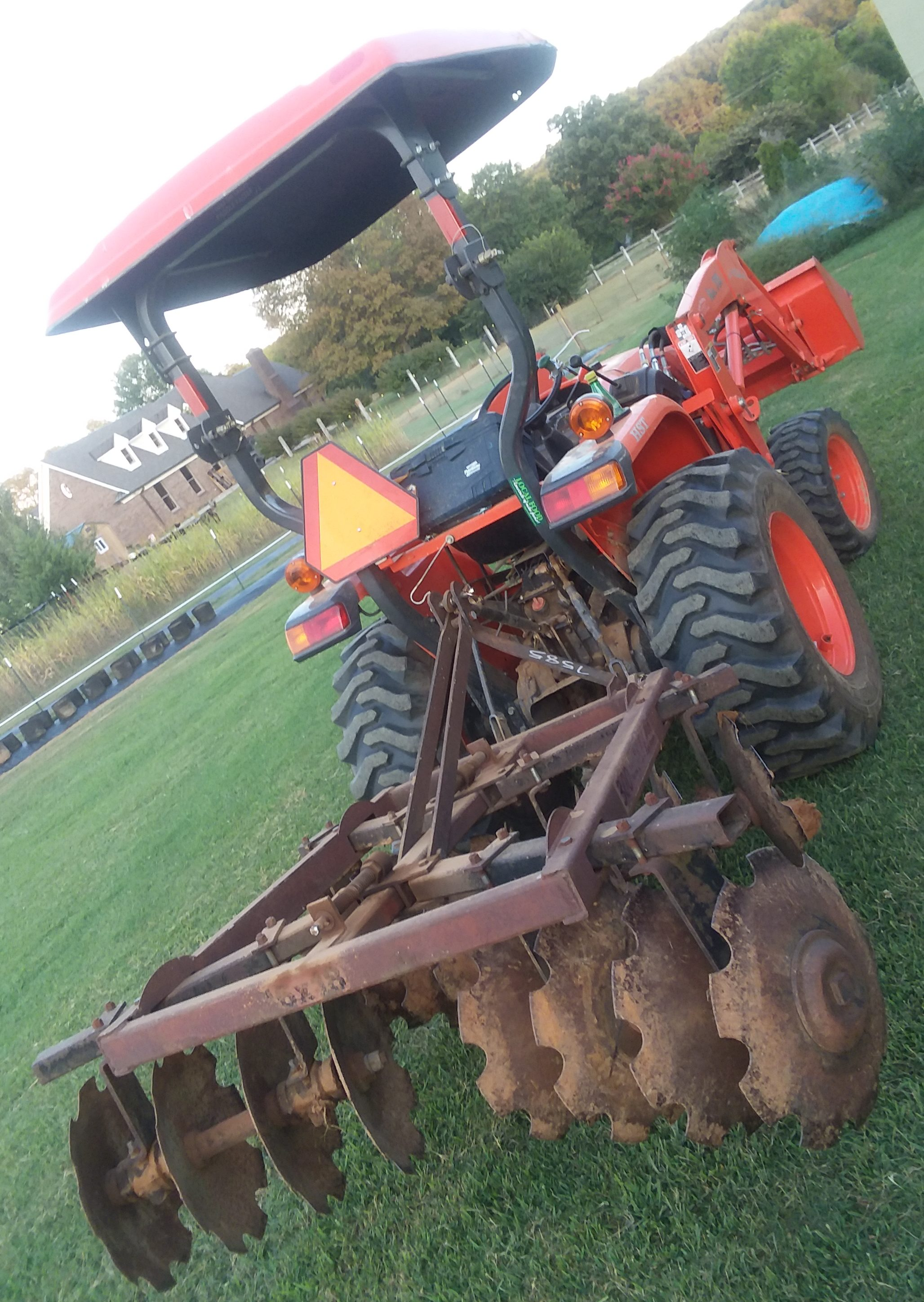 This is how the disc harrow looks when mounted to our Kubota L3800. The harrow weighs about 300 pounds and is about 6 at it's widest point so it's a good fit.